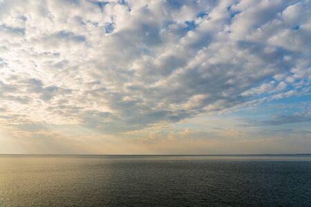 Sun light through the sky blast over the sea