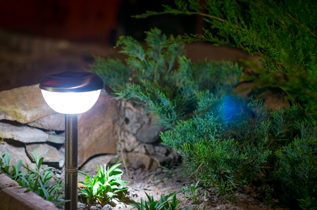solar lanterns garden light with shrubs and rock at home Stock Photo - 77960794