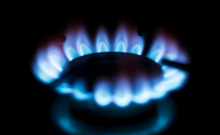 circle gas flame at home kitchen isolated on black