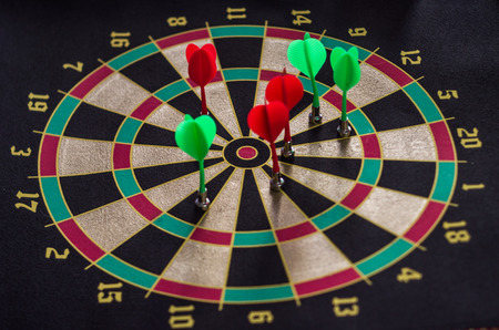entertainment center: all in target darts game with saturated colors Stock Photo