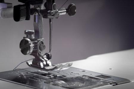 Metallic sewing machine foot. Studio light macro photo