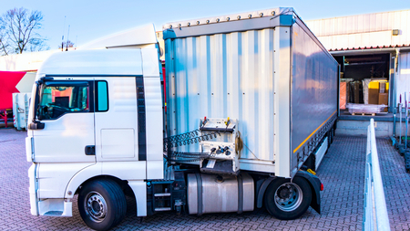 Loading Lorry Trailer. Truck on the road. Commercial transport. truck transport container Banco de Imagens