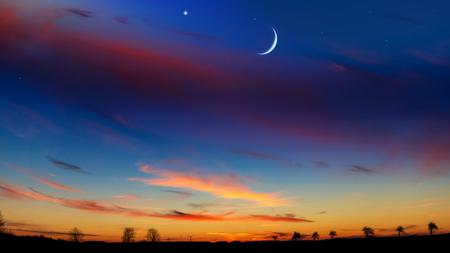 Mubarak background. Red sunset and moon. Mubarak background. Against the background of clouds. beautiful sky.
