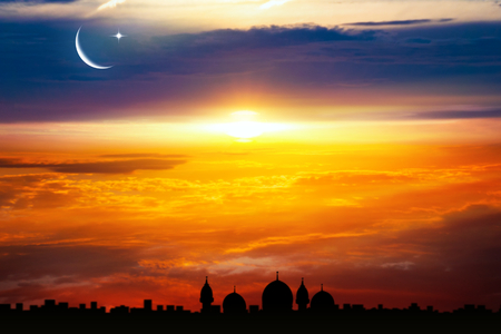 Crescent moon with beautiful sunset background. Generous Ramadan. Light from sky. Religion background. city silhouette mosque