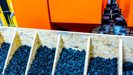Coal stock. Coal pieces texture. Heaps of coal. House boiler room