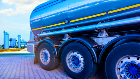 Filling Gas Station Fuel Tanks. Fuel tanker and fuel farm. Chemical Storage Tank And Tanker Truck.