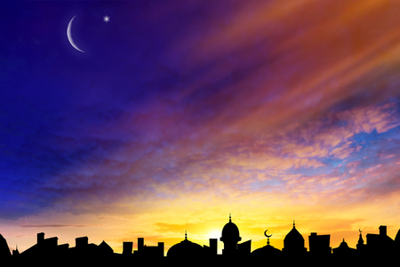 Mosque silhouette against the background of sky. Perfect sunset. Crescent moon with beautiful sunset background. Generous ramadan