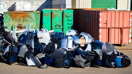Bumper auto. Recycling plastic. Colored plastic trash cans. Large wheelie bins. Urban recycling waste and garbage services