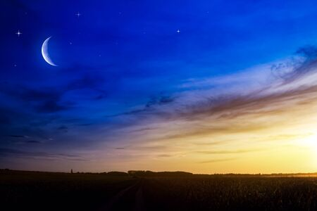 Beautifully summer landscape. Crescent moon with beautiful sunset background. Generous Ramadan. Light from sky. Religion background. Stock Photo