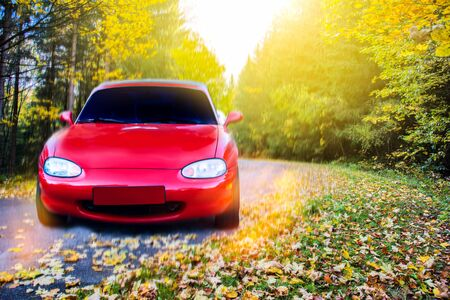 Car on a road full of dangerous bends. Red car to the road Stock Photo