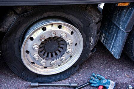 Truck wheel. Repair of cars on the road. Change wheel Stock fotó