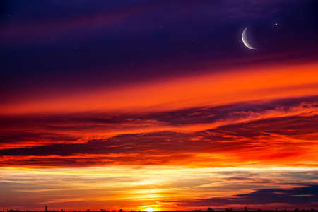 Crescent moon with beautiful sunset background. Generous Ramadan. Religion background Reklamní fotografie