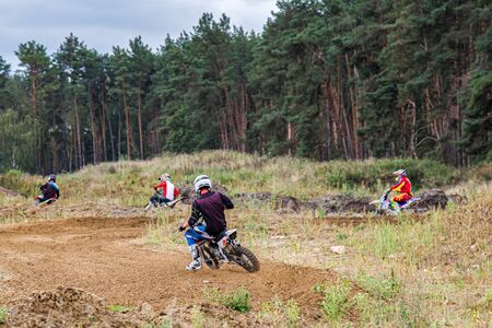 Motocross rider on a practice field. Front View Shot of the Professional Motocross. Dirt Track. Banco de Imagens
