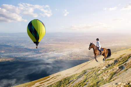 Rider of an elegant woman riding her horse. to catch up with the balloon
