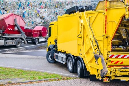 Urban recycling waste and garbage services. the garbage truck works.