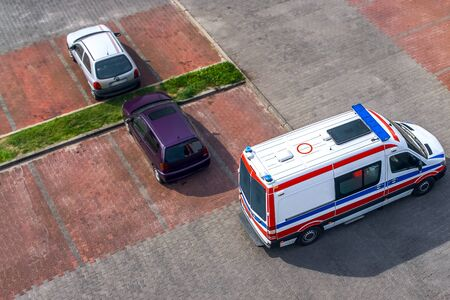 An ambulance flashes to the call. insurance medicine Stock Photo