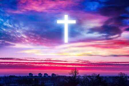 A cross over the city into the sky. background of religions
