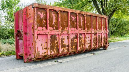 Disposal and recycling dumpster. A large, metal, garbage container and municipal waste.