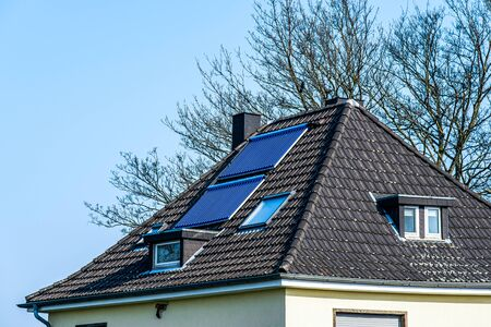 Vacuum solar water heating system on the roof of the house Standard-Bild