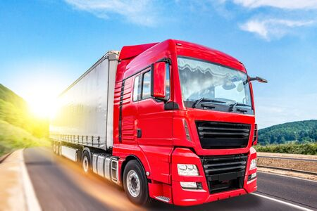 Truck moves on the road at speed, delivery of goods. Stockfoto