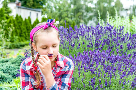 a girl with pigtails in a lavender garden dreams. breathe the flavor of Lavender