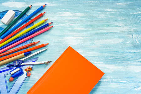 School supplies on a blue background.