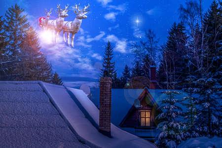 Christmas night scene - Santa Claus rides reindeer, Christmas holiday Stock Photo