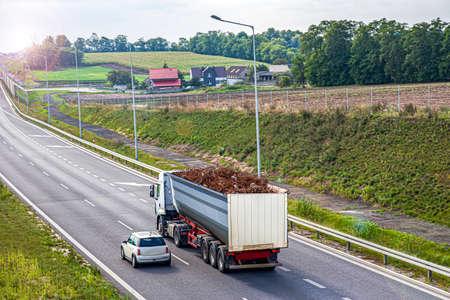 truck on the road, violation of cargo transportation 写真素材