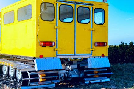 Ski resort service, yellow mobile rescue car