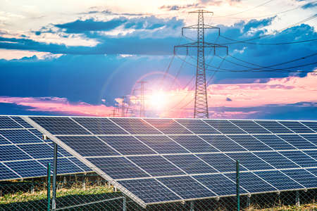 Solar panels with electricity pylons at sunset, power plant Stock fotó