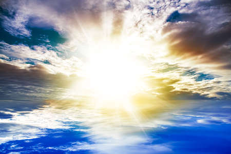 Beautiful heavenly landscape with the sun in the clouds.