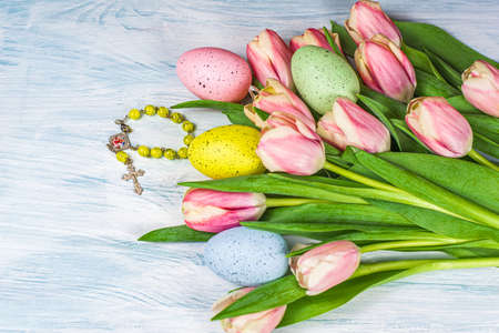 pink tulips on table, Easter background. Happy Easter background