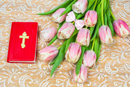 flowers and book on the table, background of religion Easter