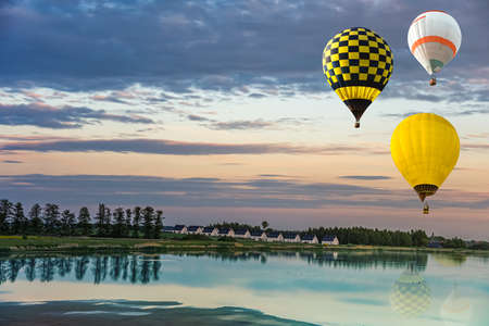 balloon over the sea, flying into the sky. good weather in summer