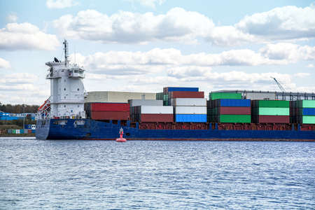 Cargo container ships on the river