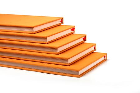 handbooks: Book pile up stair ladder shape Stock Photo