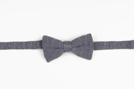 restrained: Woolen grey bow-tie for those men, who like wearing classic restrained style. Isolated on white background
