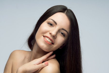 lopsided: Smiling young beautiful woman with lop-sided head , isolated on the white background Stock Photo