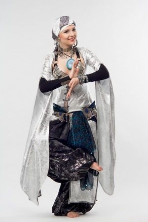 unforgettable: Full length portrait of unforgettable oriental woman, showing exiting motions of dance  Isolated on the white background