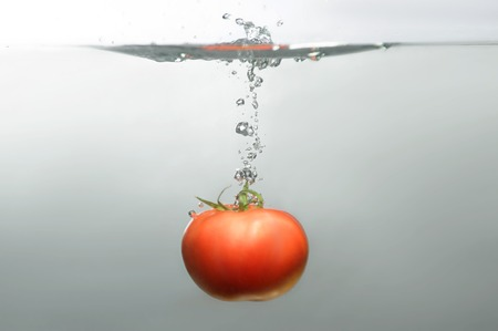 subsea: Red tempting subsea tomato with little air bubbles