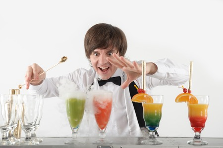 conjuring: Half-length portrait of very excited bartender conjuring with his matchless cocktails