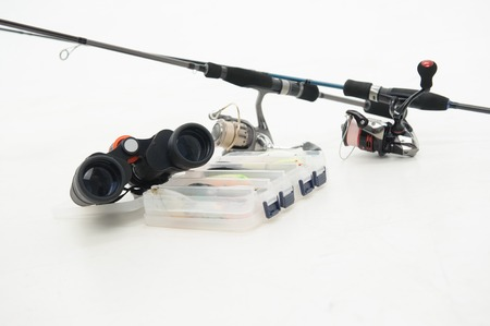 Great spinners binoculars and plastic box for flies are the necessary things for your fishing  Isolated on white background photo