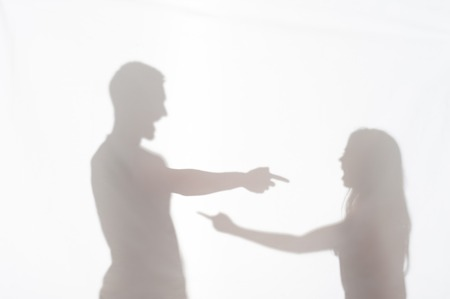 wife beater: Silhouette of man and woman standing on white background making clear their relationships