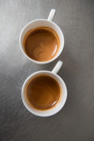 Two cups of espresso standing on the bar counter  Top view  photo