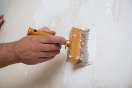 bleaching: Painter bleaching the linen with the paintbrush