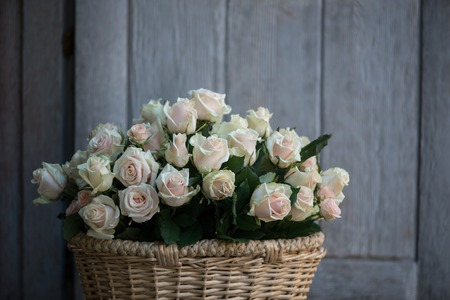 coronet: Wonderful basket with white roses standing in the wooden house