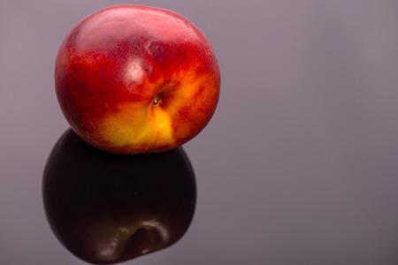 vitreous: Wonderful delicious nectarine lying on the dark vitreous surface