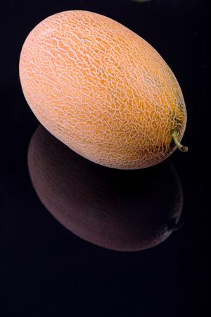 vitreous: Wonderful ripe melon lying on the black vitreous surface