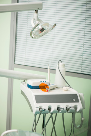 Portrait of dental chair in mental and white photo