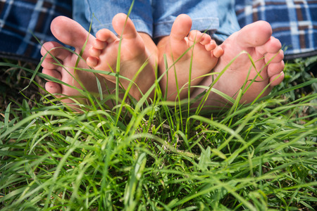 Someones bare feet lying on the grass photo